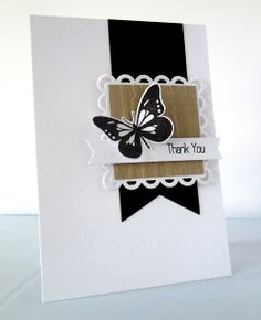 Simple, yet elegant. Could be done in all sorts of colours. I see the butterfly in autumn tones against the brown, with autumn tones embossed onto the black banner... mmm.