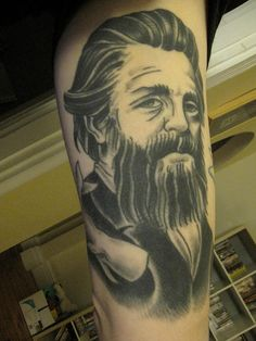 Tattoo of Herman Melville with Moby Dick. A novel about obsession encourages obsession.