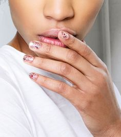 For a quick holiday touch add some sparkle to your nails like the models at Tracy Reese