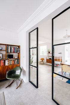 Mid-century themed renovation in Wanstead.  We joined up 2 houses into a single dwelling and remodelled the internal layout.  The ground floor now has a free layout only divided by black steel frame doors.