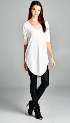 Loose fit, three-quarter length dolman sleeve, scoop v-neck tunic top. Has…