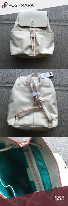 Tracy Negoshian Faux Leather Backpack This is not only beautiful, but functional, too!! What a perfect bag for traveling or for just shopping around town. The luxurious cream color goes with everything, while the light coral trim makes it feel special. Tracy Negoshian Bags