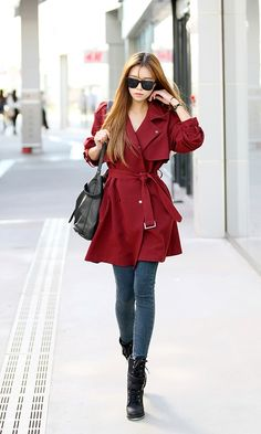 red trench, jeggings, combat boots, bag, and sunglasses