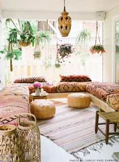 Plants, pours, Moroccan wedding blanket and lanterns