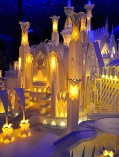 papercraft castle - reminds me of the elfin pottery castle in Ella Enchanted that glowed merrily when a candle was lit within.