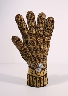 "Glove in the Pheasant's Eye Pattern, ""JCB"" at wrist"