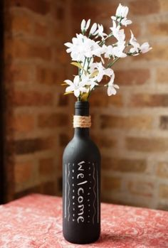 Chalkboard painted wine bottles.... fill them with flowers and write love sayings on them... simple & cute wedding center piece