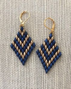 Blue earrings ,Gold Earrings, handmade, beaded earrings - - These earrings are woven in blue and gold Czech glass beads with gold filled ear wires Measures 2 inches long Lightweight and comfortable Makes a wonderful holiday gift . Blue Earrings, Diy Earrings, Earrings Handmade, Handmade Jewelry, Pearl Earrings, Seed Bead Jewelry, Bead Jewellery, Jewelry Findings, Ruby Jewelry