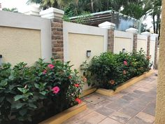 Hibiscus bloom along the compound House Fence Design, Front Wall Design, Modern Fence Design, Door Gate Design, Small Backyard Design, Backyard Garden Design, Wall Exterior, Exterior Design, Concrete Fence Wall
