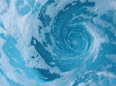 I would paint a big blue whirlpool that on a big bed sheet and spread it at and angle faced towards the audience when the part of the book comes when Charybdis eats Odysseus's ship and crew.