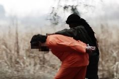 Gruesome: The victim is led to his death by the boy- chilling ISIS video of English speaking child beheading his victim - The child says that he does this as instructed by the Quran...THIS IS ISLAM!!!!