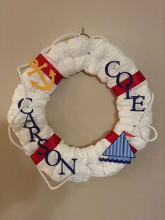 Nautical Baby Shower Diaper Wreath....cute but I dont know how hard it would be to make.