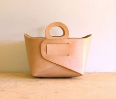 Leather Storage Tote // I love this design detail, no sewing or glueing, just elegant folded + tucked joins #productdesign