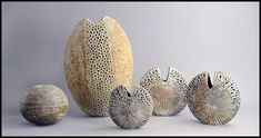 Alan Wallwork, own studio, UK Grouping of unique stoneware sculptural forms with matte grey, brown, and orange glazes. Freeforms