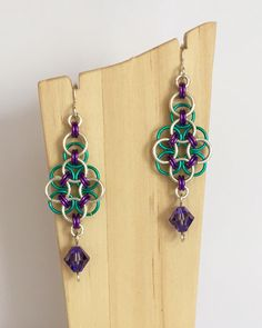 A personal favourite from my Etsy shop https://www.etsy.com/uk/listing/399427469/peacock-earrings-chainmaille-earrings