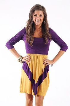 """Aim For It Dress, Purple/Gold $38.00 We couldn't pick a better game day dress for a nice fall Saturday football game! Show your team spirit and have a look you can wear again and again!   Fits true to size. Miranda is wearing a small.   From shoulder to hem:  Small- 34.5""""  Medium- 35""""  Large- 35.5"""""""