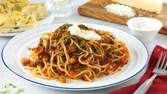 This spaghetti Bolognese is a dinner-time favorite. The herbs, red wine and rich Hellmann's® or Best Foods® Real Mayonnaise brings big flavor to this simple dish.