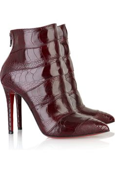 Christian Louboutin ~ Dark-red leather ankle boots with a stiletto heel, a faux-snake print, a pointed toe, a zip fastening along back and the signature red sole.
