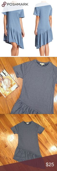 ✨NEW✨ NWOT Asymmetrical SS Knit Ruffle Dress NWOT asymmetrical ruffle hem knit short sleeve dress |  Cozy baby french Terry knit with flowy silhouette |  Perfect for a day out and about! Pairs back nicely to sandals |  Never worn - polybag was opened to showcase | Color = Denim |   💵 offers welcome 🛍 bundle and save painted threads Dresses Asymmetrical