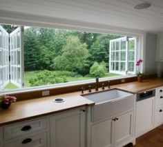 kitchen wall of windows that open up.