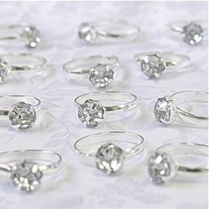 Cute Engagement Diamond Rings to use as favors, napkin rings or table decor.  Pack of 12 $5.99 Amaon.com