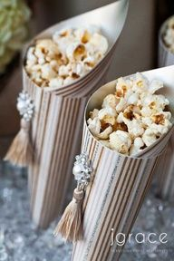 Fun idea to try...using different papers and decorations....could put white puppy chow in it for wedding.
