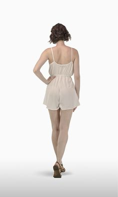 The Lola Romper in Ivory Crepe | Who doesn't love a jumpsuit short? It's definitely the best choice for a hot summer day on the beach or in town.  JOSA tulum Lola is the next best thing to going naked, with its spaghetti straps, loose fit and V-cut neckline that shows all your sexy assets . . . or you can clip button for a less showy occasion.