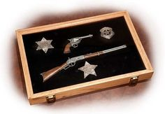 This pine wood display showcases the elements that worked together to tame the Wild West: the lawman and his weapons of choice. Us Marshals, Wood Display, Nickel Silver, Western Decor, Black Felt, Old West, Site Design, Over The Years, Badge