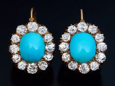 Antique Victorian Turquoise and Diamond Cluster Earrings, circa 1890 The 14K gold dangle earrings are centered with cabochon cut sky blue Persian turquoise surrounded by sparkling old mine cut diamonds. Two cabochon cut turquoise (approximately 9 x 7.5 mm) Twenty four (24) old brilliant cut diamonds, estimated total diamond weight 3 carats  Size of the clusters 16 x 14 mm  Length with ear wire 22 mm (7/8 in.)