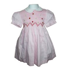 """Victoria (Pink) - Traditional smocked dress with embroidery overlay.  Styled with short """"cuff"""" sleeves and """"Peter Pan"""" collar. Button fastening at the back, with matching fabric """"ribbons"""" to tie a bow.  Fabric piping to collar and cuffs to compliment embroidery. Available in sizes 6 months - 8 years."""