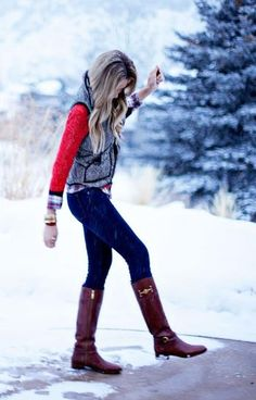 Herringbone vest, red sweater, plaid shirt, dark skinny jeans, brown riding boots