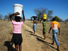 Girls Carrying Water in Madagascar