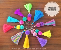 These pom-pom key chains are perfect for add a colorful touch to your keys, bags, tote bag, purses, pouches. -- You will receive exactly what you see in photos. -- Measures: -LENGHT: inches / 19 cms - MADE OF: Worsted yarn - Metal hooks swivel snap Pom Pom Crafts, Yarn Crafts, Diy And Crafts, Crafts For Kids, Arts And Crafts, Diy Tassel, Tassels, Craft Projects, Sewing Projects