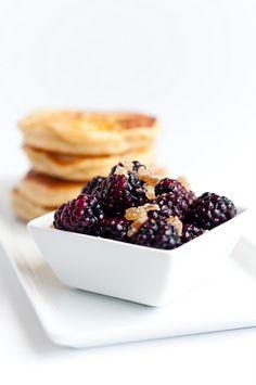 Apple-ginger pancakes with warmed blackberries