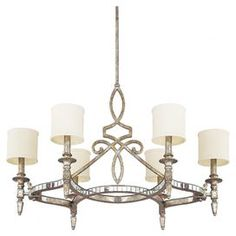 Metal chandelier with a silver and gold leaf finish and cylindrical fabric shades.   Product: ChandelierConstruction Material: Metal and fabricColor: Silver and gold leafAccommodates: (6) 60 Watt candelabra base bulbs - not includedDimensions: 26 H x 37.5 Diameter