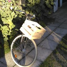 I just finished putting a new bicycle basket (KNAGGLIG wooden box from Ikea) on…