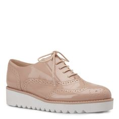 Nine West lace-up oxfords in blush.