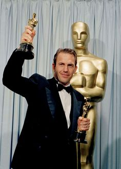 Kevin Costner holds up his Best Picture and Best Director statuettes for Dances with Wolves. Kevin Costner holds up his Best Picture and Best Director statuettes for Kevin Costner, Oscar Academy Awards, Academy Award Winners, Hollywood Stars, Classic Hollywood, Les Oscars, Photo Star, Dances With Wolves, Actor Studio