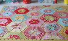 From - lovely little handmades: easy double hexagon pillow tutorial! - would work with larger strips and could be made into a simple quilt. :)