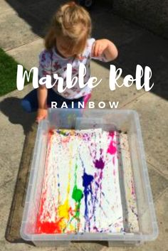 Marble rolling through rainbow paint colours. One of 10 easy to set up activities for your little people  http://squidgeandboo.com/sensory-play/10-simple-activities-you-can-set-up-using-things-you-already-have/