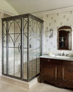 Another slightly more traditional take on the glass shower. I like everything but the tile.
