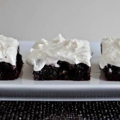 Red Velvet Brownies With White Chocolate Frosting (via foodily.com)