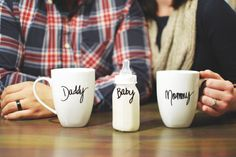 Nick + Natalie | Baby Announcement...I like this idea...would use beer stein for daddy and could use sippy cup for adopted child anouncement :)