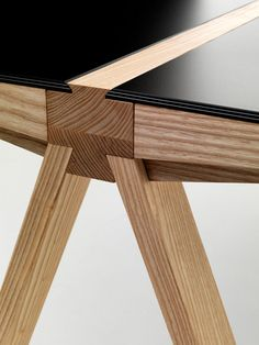 Francesco Faccin's Traverso table exaggerates the primary supporting beam as both a functional part of the structure and an aesthetic detail. The unique ash