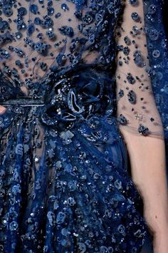 Midnight blue is a very beautiful color, though you may say it's too dark for a wedding, I think it's not – it looks mysterious and unique. I just love those midnight blue dresses – especially sparkling ones - that designers create!