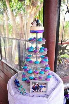 Purple and turquoise wedding cupcakes by Cupcake Passion--- I think I like the idea of cupcakes instead of a wedding cake and then a small cake for our 1st anniversary and one to cut at the wedding. Maybe alternating two color frostings to code two different flavors.