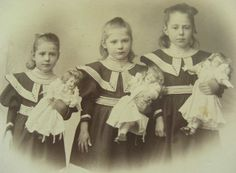 three sisters and their dolls