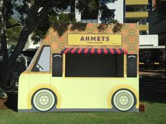 Ahmet's Turkish Cuisine. Pop up restaurant! Kiosk design idea. Instead of making a kiosk look like  a building-- having it look like a food truck. Shows how far food trucks have come!