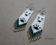 Items similar to Hand Seed Bead White Wolf Native style beaded earrings 3 on Etsy Beaded Earrings Patterns, Seed Bead Patterns, Beading Patterns, Beading Tutorials, Bracelet Patterns, Seed Bead Jewelry, Seed Bead Earrings, Seed Beads, Native Beadwork