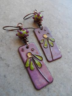 Pretty enameled copper charms, expertly handcrafted by an etsy artisan, are perfectly paired with artisan-made lampwork beads. Copper bead caps and spacers add the final touch. Wire-wrapped together with solid oxidized copper wire and suspended from copper earwires, these adorable